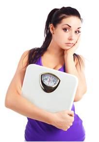 Ako schudnúť - žena s váhou